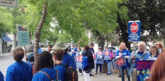 Postal workers picket of Staples to boycott the stores' use of non-union workers providing postal services