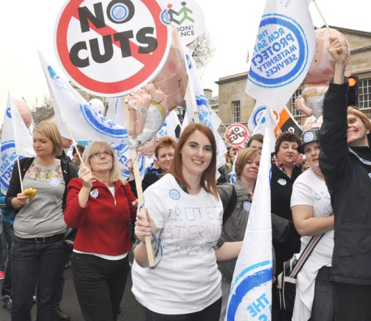 Nurses on a TUC demonstration demand no cuts to the NHS