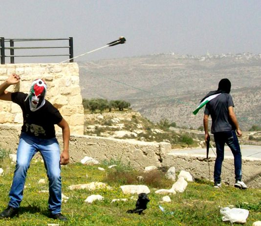 Young Palestinian has only a sling to defend his village from incusions by armed Israeli settlers