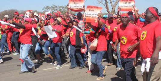 NUMSA auto workers marching during their strike last September