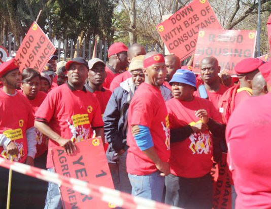 NUMSA members picket the Eskom power company head offices in Sunninghill on the outskirts of Johannesburg