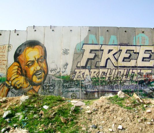 Mural depicting Marwan al-Barghouthi painted on the separation wall at the Qalandia checkpoint in Ramallah