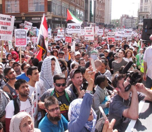 A section of the huge angry crowd rallying in Kensington High Street outside the Israeli embassy last Saturday
