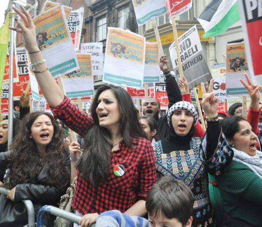 'Free, free Palestine' chant protesters outside the Israeli embassy in london