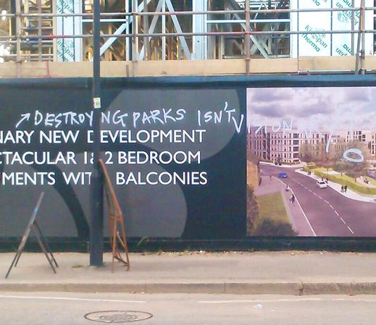 Graffiti on the billboard of the Myatts Field North 'regeneration' site. Residents are protesting at their building site conditions