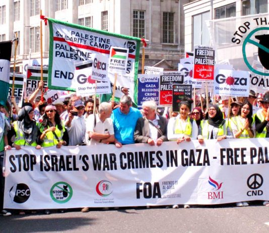 The front of Saturday's 120,000-strong march sets off from outside the Israeli embassy in London