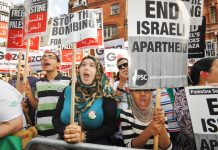 A section of last Friday's 10,000-strong demonstration outside the Israeli embassy in London demanding an end to the Israeli onslaught on Gaza