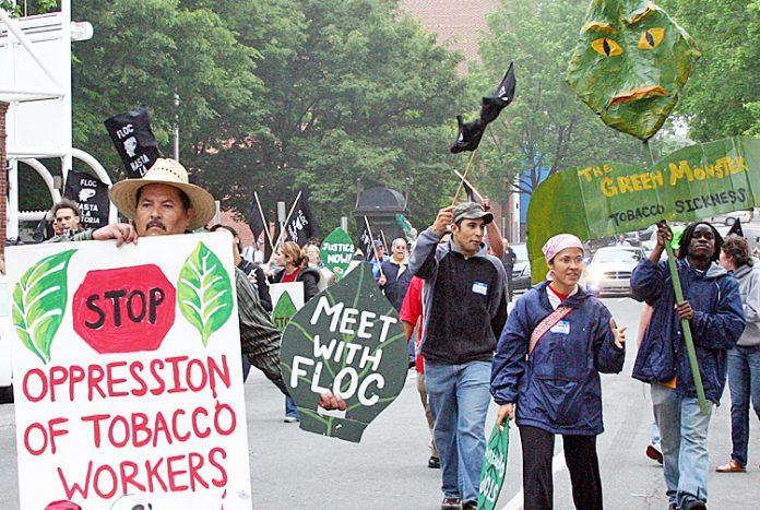 Tobacco workers marching to demand the employers meet with the Farm Laborers Organizing Committee