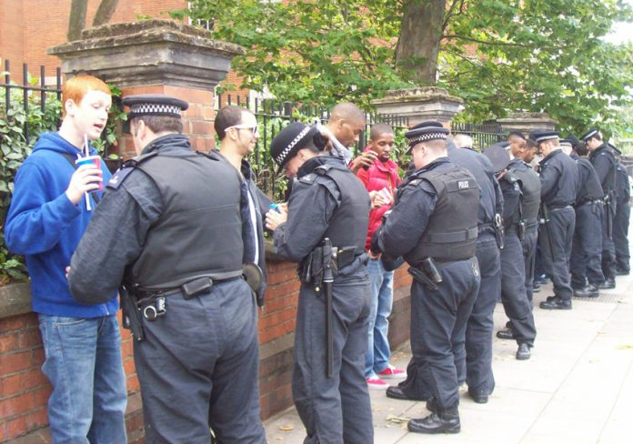 Youth on their way to the Notting Hill Carnival are stopped and searched by police