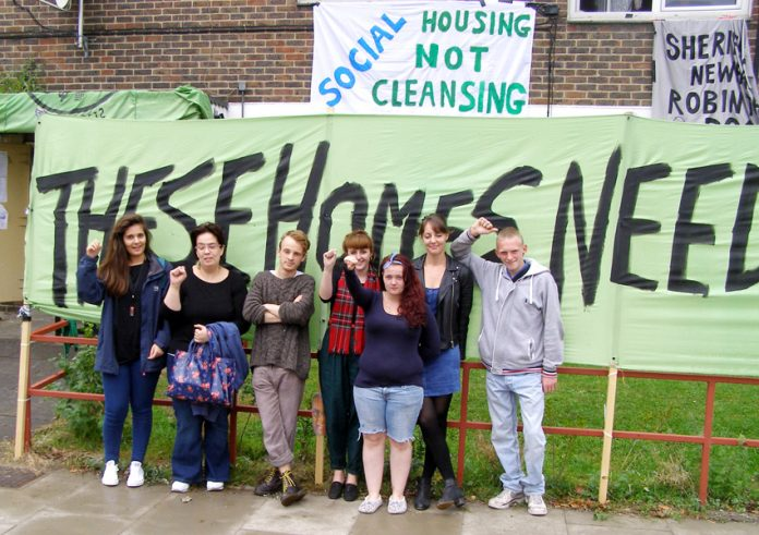 E15 Focus Mothers Group and their supporters outside the four empty flats on the Carpenter's Estate which are now occupied