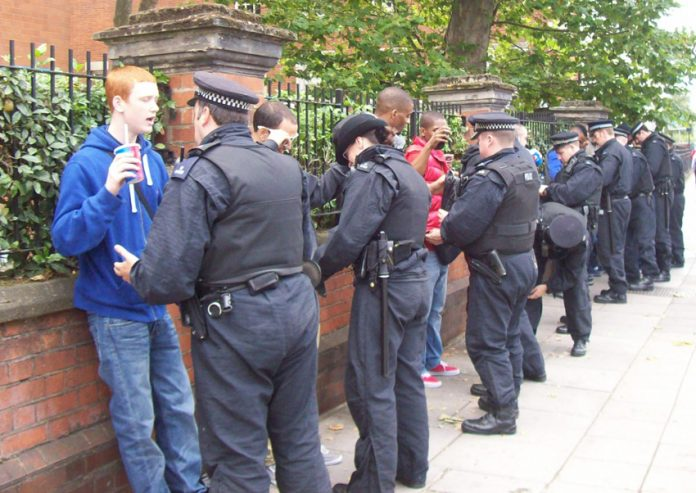 Mass stop and search of youth on the street in west London – May's proposed powers would drive Britain towards a police-military dictatorship
