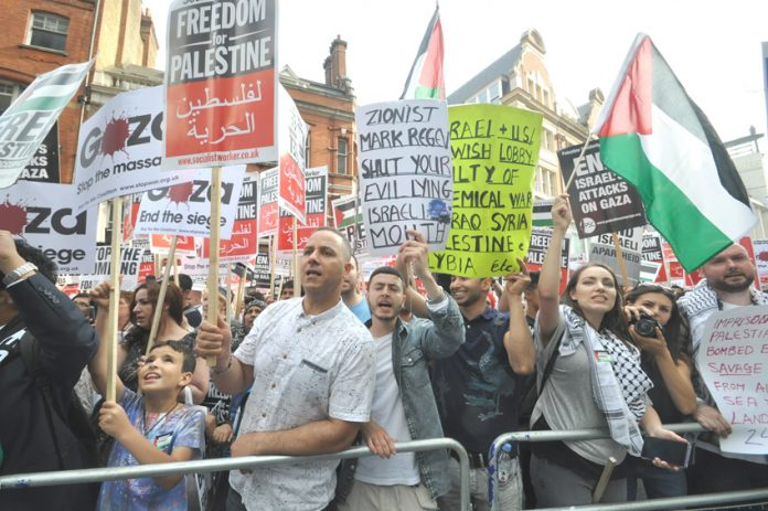 Demonstrators outside the Israeli embassy in London in August condemn Israeli lies during its assault on Gaza