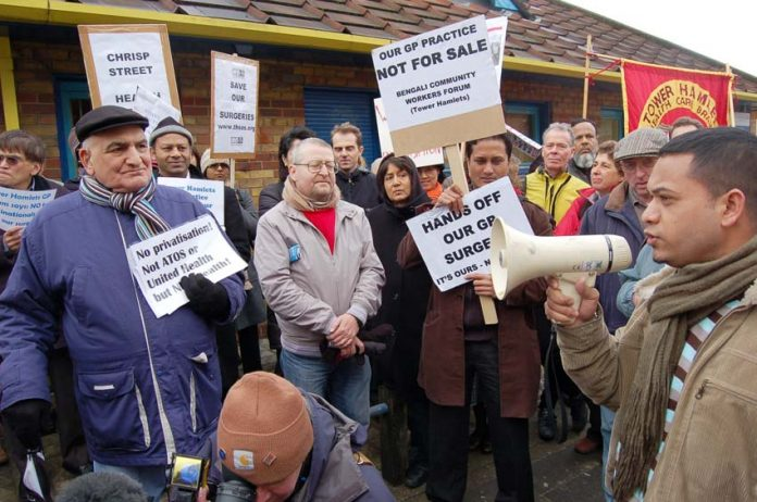 GPs and patients demonstrate against the threat of closure of 22 GP surgeries in East London alone
