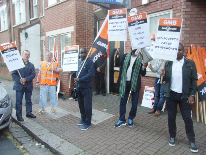 Striking traffic wardens on the picket line in Yukon Road in Balham south-west London