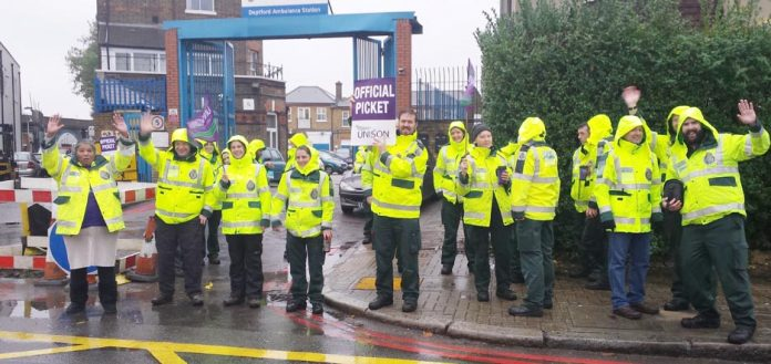 Solid picket line of ambulance workers at the Deptford Ambulance Station