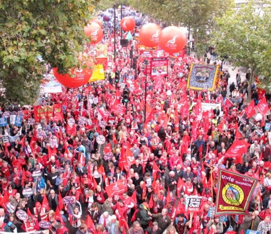 Unite banners assemble on London's Embankment at the front of Saturday's 150,000-strong march