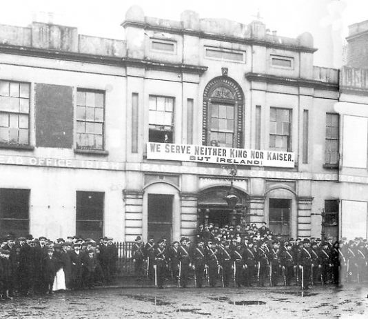 Irish Citizens Army members parade outside Liberty Hall