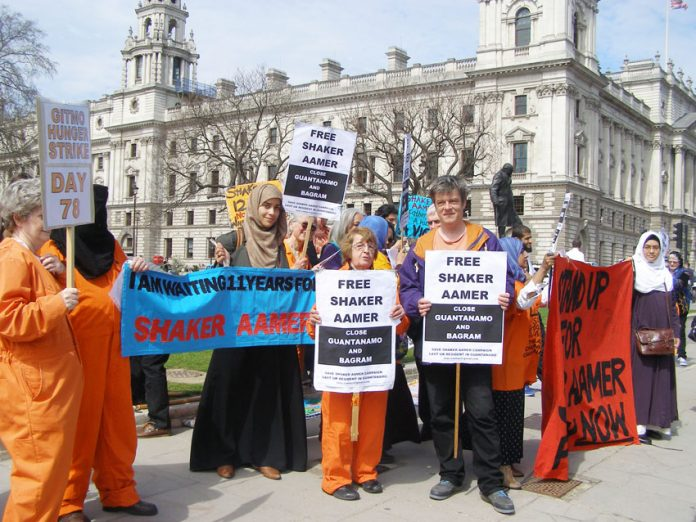Protest outside parliament in London, England demanding the release of Shaker Aamer from detention in Guantanamo Bay prison
