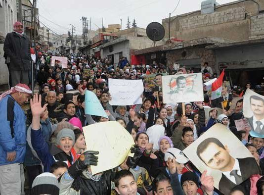 Syrians show their support for President Assad in Al Naabeck