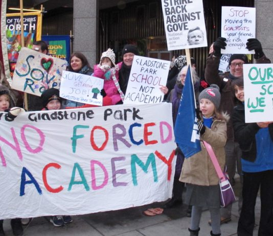Teachers, parents and pupils demonstrate against academy schools