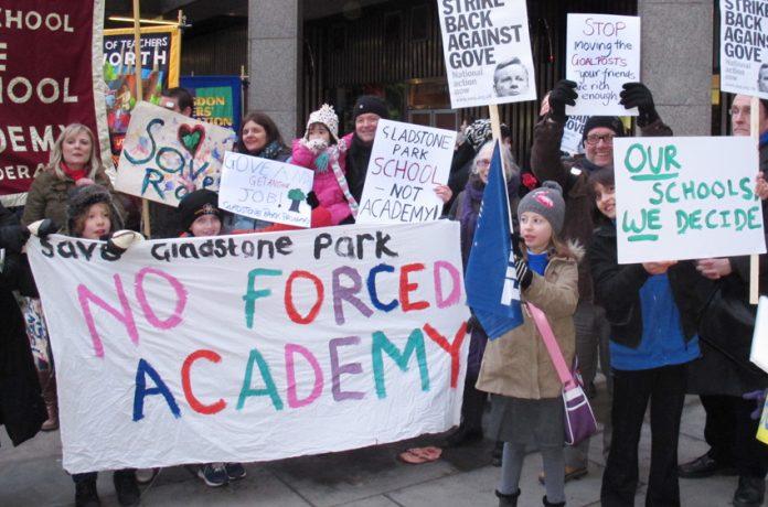 Teachers, parents and pupils demonstrate against academy schools