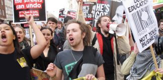 Angry students marching through central London demanding an end to all tuition fees, the restoration of grants and no privatisation