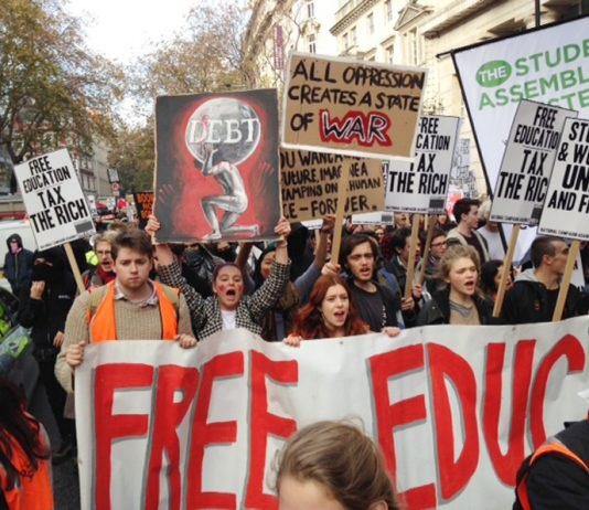 Students marched from the University of London Union to Parliament yesterday demanding free state education. In Parliament Square they tore down the fences and occupied