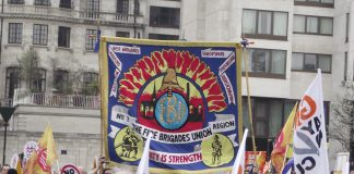 West Midlands FBU banner on a TUC march in London against government cuts