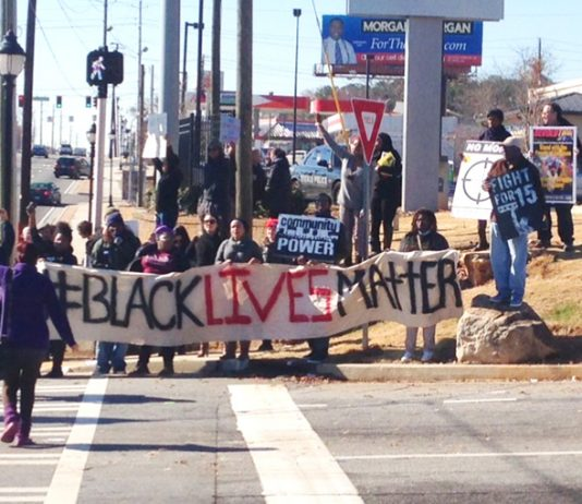 Walmart workers and Ferguson protesters picket a Walmart store in Atlanta