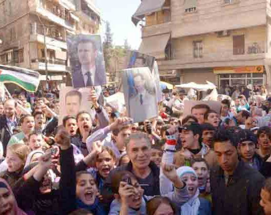 Syrians show their support for president Assad and the Palestinian struggle