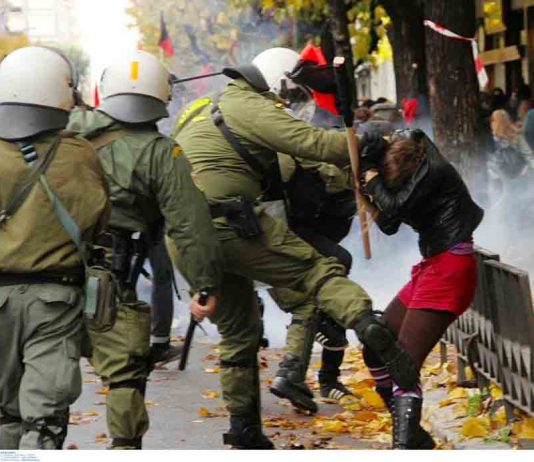 Greek riot police attack a young female demonstrator in Athens last Saturday. Photo credit: Left.gr
