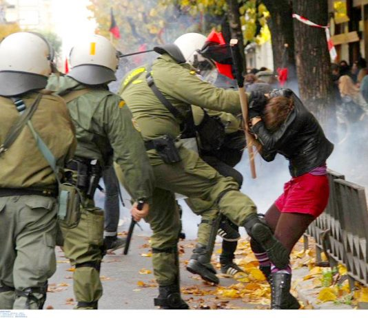 Greek soldier kicking a girl on a demonstration in Athens on the anniversary of the police shooting of 15-year-old Alexis Grigoropoulis. Photo credit: Left.gr