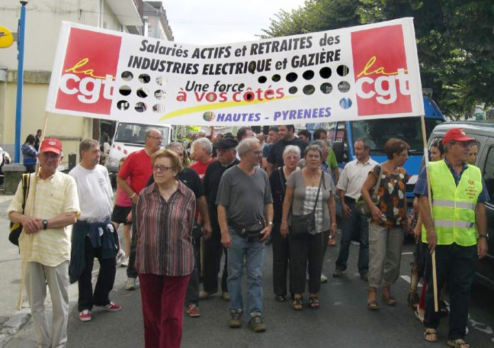CGT members marching against pay and pension cuts for gas and electricity workers