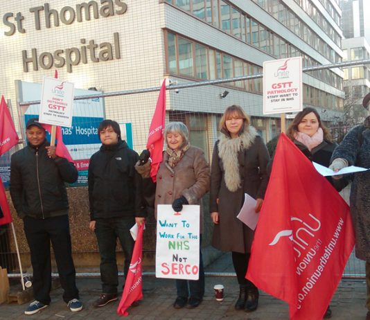 Pathology strikers deliver their message from the picket line at St Thomas' Hospital on Westminster Bridge