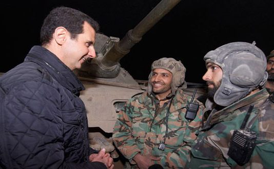 Syrian President BASHAR AL ASSAD greeting soldiers at a military post on the firing line at Jobar in the Damascus coutryside over the New Year