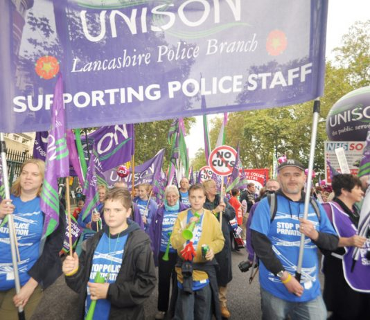 Unison police staff and their families marching against privatisation of the service – they will be striking over pay next Friday