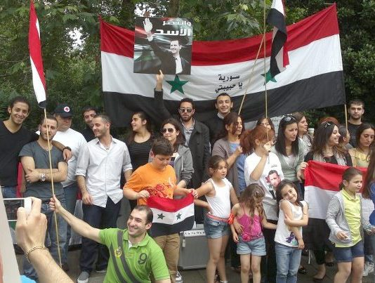 Syrians show their support for President Assad at a demonstration in London