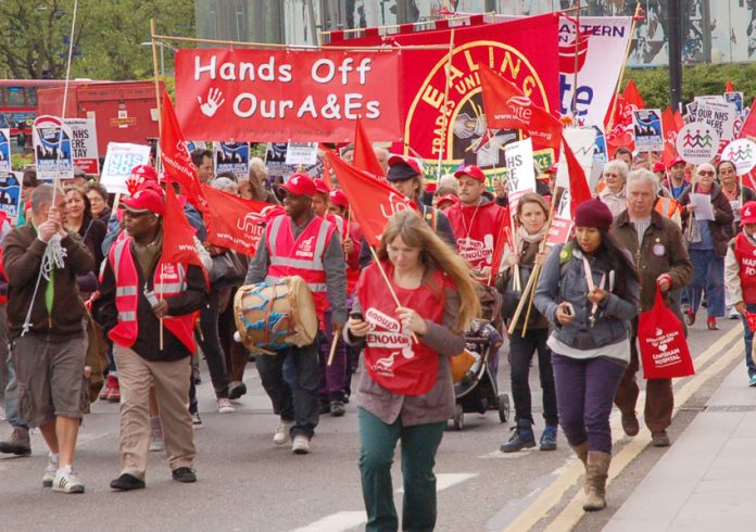 Health workers marching through London in May 2013 – protesting against plans to cut and close A&Es