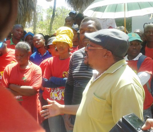 NUMSA deputy general secretary KARL CLOETE addressing his members at a rally outside the Glencore mining corporation offices
