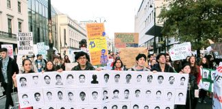 Students on a demonstration against tuition fees in London last November holding pictures of the 43 disappeared Mexican students