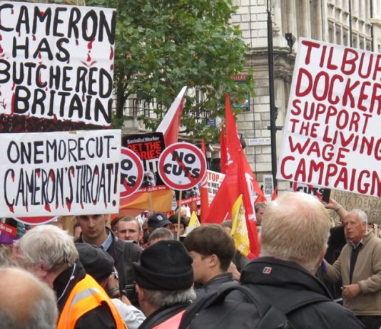 Trade unionists made their mind up about the role that Cameron and the Tory Party were playing a long time ago – picture shows placards from the October 2012 TUC demonstration against austerity in London