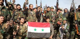 Syrian troops celebrate a victory in Yabroud, near the border with Lebanon