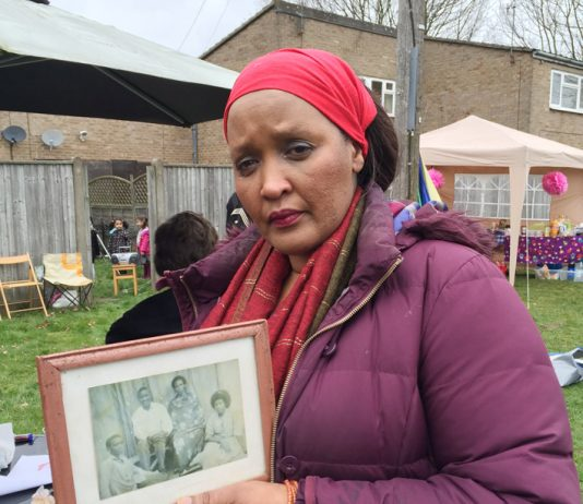 ENID MUTESI was evicted last Wednesday – shown holding a framed picture of her parents which she found in the bin