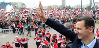 Syrian president ASSAD waves to supporters during a recent rally
