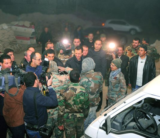 Syrian president BASHAR AL-ASSAD visiting troops on the front line on New Year's Eve