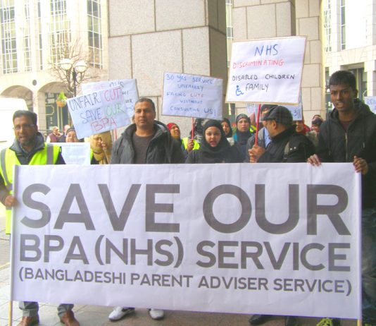 'Mayor come down! Don't cut our service!' shouted families fighting against cuts to the disability service outside Tower Hamlets Town Hall yesterday lunchtime