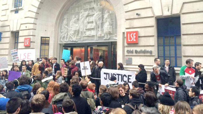 Students demonstrate outside the London School of Economics where they have been occupying since March 17