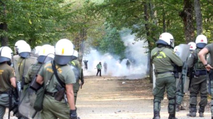 Riot police attacking villagers with tear gas in Skouries, northern Greece. Photo left.gr