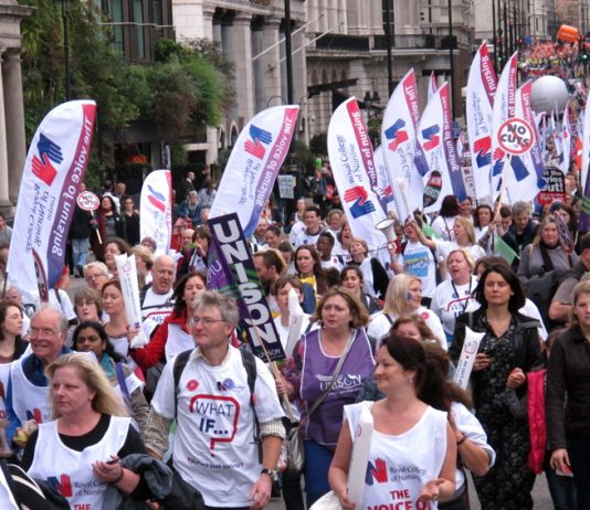 RCN nurses marching on a TUC demonstration last October – there are now fewer nurses than there were in 2010