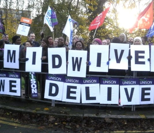 NHS workers on the picket line at Northwick Park Hospital in north-west London during last November's NHS strike action. They are demanding 3,000 more midwives and will fight any attempt to impose a 'staff freeze'